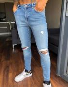 ASOS DESIGN - Mid wash blå spray on-jeans i vintage look med power str...
